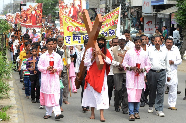 March 29, 2013: An Indian Christian devotee portraying Jesus Christ, (C) carries a cross as he takes part in a Good Friday procession commemorating the crucifixion of Jesus Christ in Amritsar. Christians account for 2.3 percent of India's billion-plus Hindu majority population. (Narinder Nanu/AFP/Getty Images