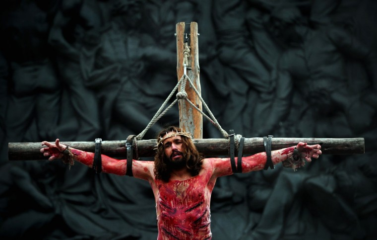 March 29, 2013: An actor playing Jesus hangs on a cross during a performance of the Passion of Jesus by the Wintershall Players in Trafalgar Square, central London. (Carl Court/AFP/Getty Images)
