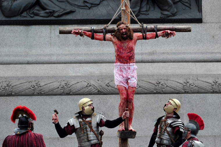 March 29, 2013: An actor playing Jesus hangs on a cross during a performance of the Passion of Jesus by the Wintershall Players in Trafalgar Square, central London. (Carl Court/AFP/Getty Images
