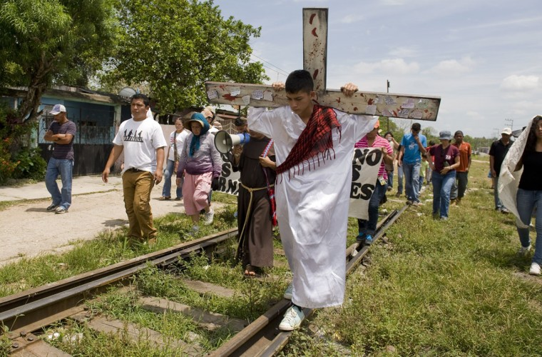 March 29, 2013: Guatemalan migrant Kevin plays Jesus Christ during the Via Crucis at the Obrera neighborhood in Tenosique, state of Tabasco, Mexico near the border with Guatemala. (Alfredo Estrella/AFP/Getty Images)
