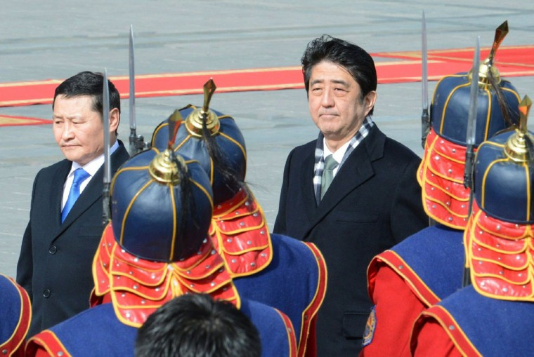 Japanese Prime Minister Shinzo Abe, right, accompanied by his Mongolian counterpart Altankhuyag Norov, reviews honor guards during a welcoming ceremony in Ulan Bator on March 30, 2013. Abe arrived at Mongolia's capital on a two-day official visit. (STR/AFP/Getty Images)