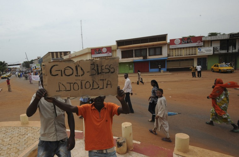 Supporters of newly elected Central African Republic President Michel Djotodia hold a cardboard sign during a march in the streets of Bangui on March 30, 2013. The Central African Republic's new strongman Michel Djotodia vowed Saturday not to contest 2016 polls and hand over power at the end of the three-year transition, he declared after his coup a week ago. (Sia Kambou/AFP/Getty Images)