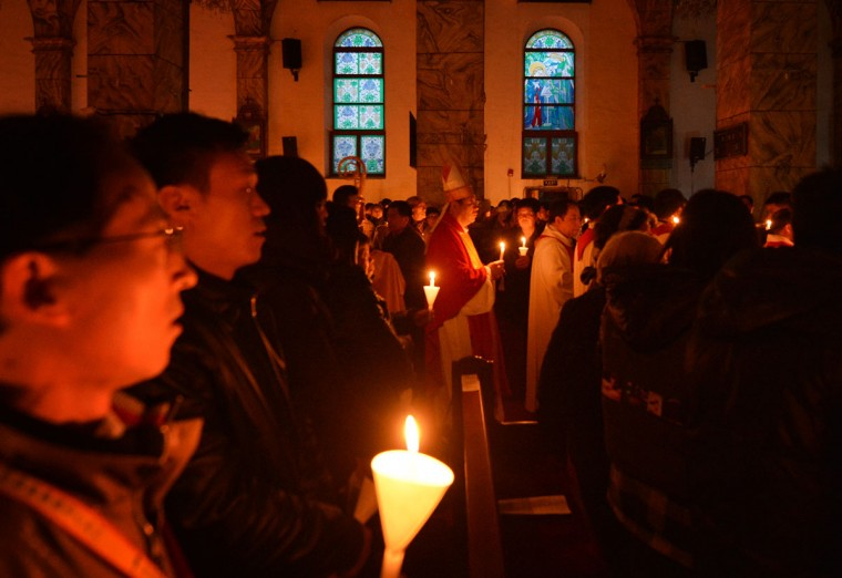 "Chinese Catholic clergy arrive for an Easter service at the Cathedral of the Immaculate Conception, in Beijing on March 30, 2013. Experts say China has as many as 12 million Catholics, with about half belonging to the state-run Chinese Catholic Patriotic Association (CCPA) and the rest in ""underground"" churches, though many operate openly depending on the stance of local officials. (Mark Ralston/AFP/Getty Images)"