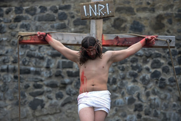 An actor representing Jesus Christ performs during a re-enactment of the Passion of the Christ on the Easter Saturday on March 30, 2013, in Ceska Lipa, Czech Republic. (Michael Cizek/AFP/Getty Images)