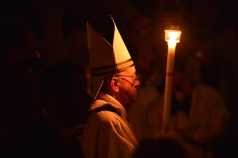 Pope Francis holds a candle during the Easter Vigil on Holy Saturday at the St Peter's basilica on March 30, 2013 at the Vatican. Easter Vigil, also called the Paschal Vigil is a service held in traditional Christian churches as the first official celebration of the Resurrection of Jesus. Historically, it is during this service that people are baptized and that adult catechumens are received into full communion with the Church. (Vincenzo Pinto/AFP/Getty Images)