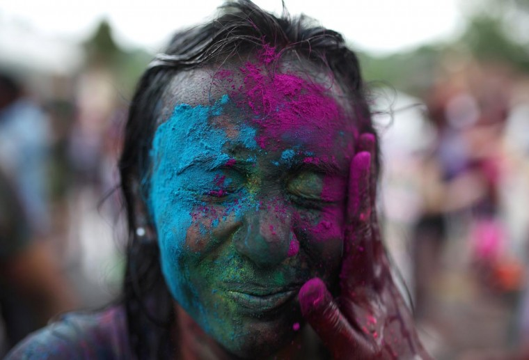 "A Hindu covered in coloured powders celebrates ""Holi"" at a temple in Kuala Lumpur on March 31, 2013. Holi, the festival of colours where people smear each other with coloured powder and water, is celebrated by Hindus across the country. (Mohd Rasfan/AFP/Getty Images)"