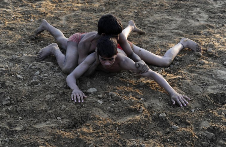 "Indian wrestlers or ""Pahalwan"" compete at a wrestling ground in the old quarters of New Delhi on March 31, 2013. India's overall Olympics record may not be much to shout about but its wrestlers have won four of the country's 13 individual medals, including the first-ever bronze by Khashaba Jadhav in Helsinki in 1952. But the sport's future looks bleak after the International Olympic Committee's executive board decided last month that it should be dropped from the 2020 Games. (Sajjad Hussain/AFP/Getty Images)"