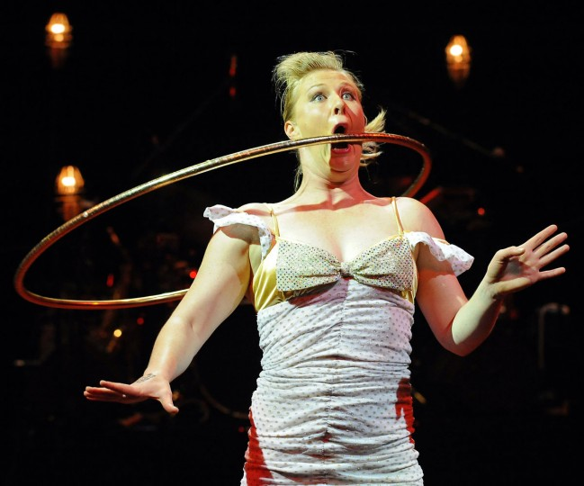 December 30, 2009: Circus Oz performer Eli Green swings a hula hoop through her mouth during the final rehearsal in Sydney. The internationally acclaimed 'Barely Contained' show is incorporated into the Sydney Festival 2010 and will run until January 26. (Torsten Blackwood/AFP/Getty Images)