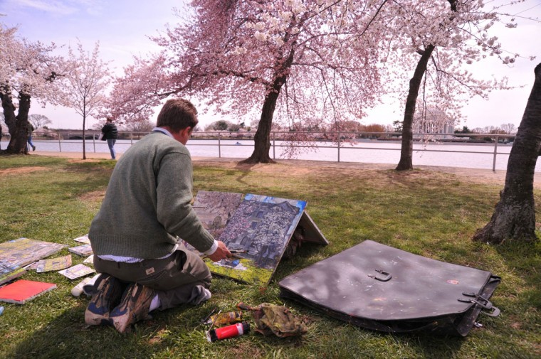 March 28, 2011: Local artist Justin Pyles puts the finishing touches on some of his cherry blossom painings along the Tidal Basin in Washington, DC. (Karen Bleier/AFP/Getty Images)