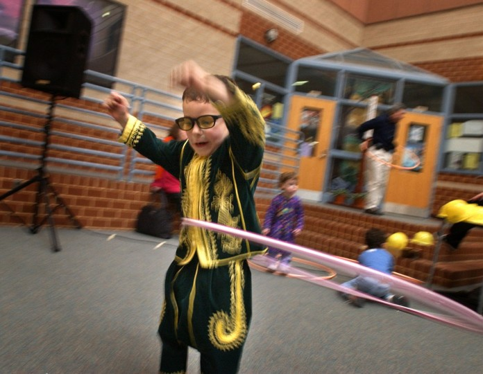 March 16, 2003: Dressed as King Mordechai, Spencer Collen, 4-1/2 works his hips with the hula hoop to music at the 11th Annual Community Purim Carnival, sponsored by the Jewish Federation of Howard County at Long Reach High School Sun. (Karl Merton Ferron/Baltimore Sun)