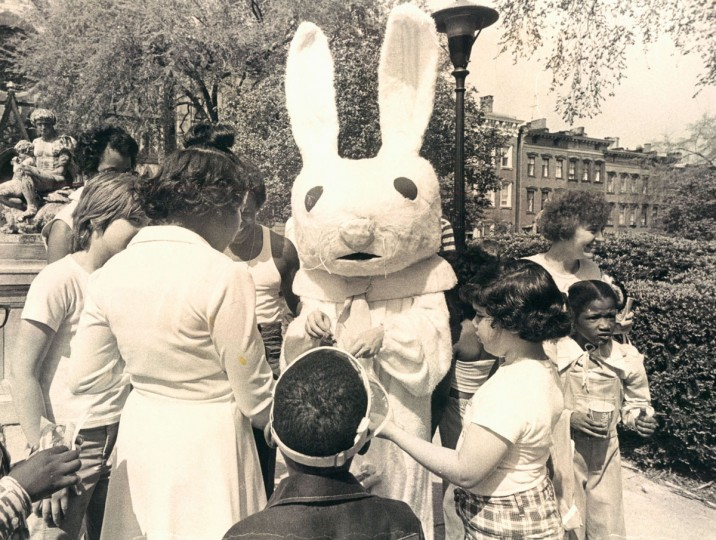 A costumed Easter bunny gives out sweets to children at the Mount Vernon Place Easter Festival in 1976. (Carl Harris, The Baltimore Sun)