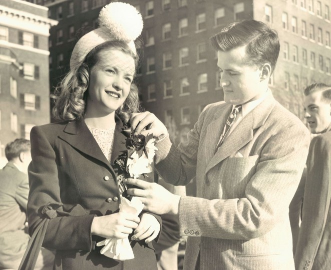 Ruth Ann Murphy has her corsage adjusted by William R. McClayton during an Easter parade on Charles Street in 1947 . (W.M. Klender, The Baltimore Sun)