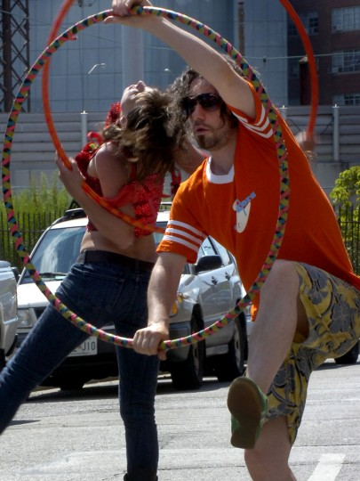 July 18, 2009: Paige Shuttleworth, also know as DJ Woman, from Baltimore, and Jim Dier, also known as Small Change, from New York, take time before they DJ to enjoy the spirit of Artscape. The two improvised movements with hula hoops on a side street off of the Midway. (Tasha Treadwell/Baltimore Sun)