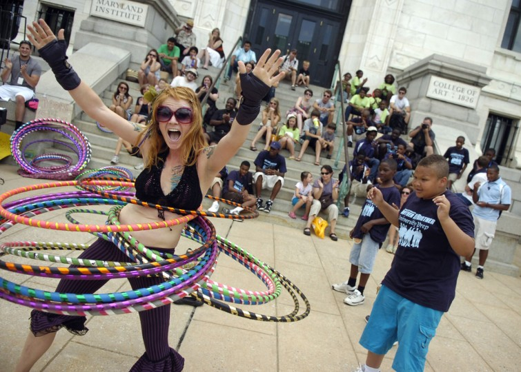 July 15, 2011: Artscape, the biggest free festival in the country, kicked off yesterday in Bolton Hill and Charles North. Kelly Jo Stull, aerial artist and street performer, swings numerous hula hoops at Artscape. (Gabe Dinsmoor/Baltimore Sun)