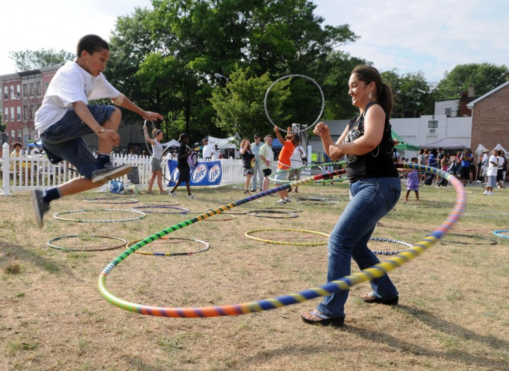June 25, 2011: Sherry Ayers of Mt. Washington hula hoops as her son Jacob attempts to jump inside during Roots Fest 2011 on W. Franklin Street. (Brian Krista/Baltimore Sun)