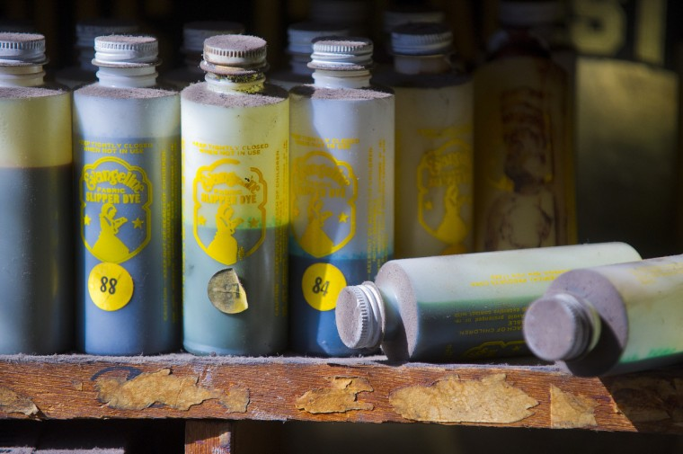 Dust covers bottles of slipper dyes at Malcolm Spaulding's corner shop. (Karl Merton Ferron/Baltimore Sun)