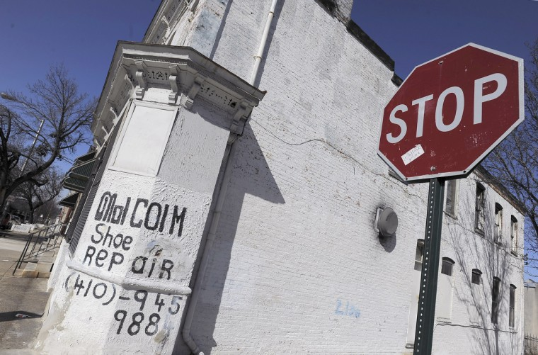 The white-washed exterior of Malcolm Spaulding's corner shop in West Baltimore Tuesday, Mar 5, 2013. The business he's kept for 37 years ends March 15, when he retires and the building is prepared to be sold. (Karl Merton Ferron/Baltimore Sun)