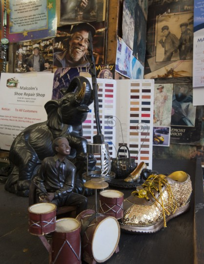 Collectibles and photos reflect the character of Malcolm Spaulding's corner shop in West Baltimore. (Karl Merton Ferron/Baltimore Sun)