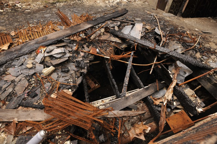 An opening in a floor shows one of many areas where vandals have set fires in fhe Henryton complex. ÒWeÕre concerned about anyone possibly being injured on the property, whether itÕs an intruder or firefighter or EMS personnel,Ó said William E. Barnard, the state fire marshal. (Kim Hairston/Baltimore Sun)