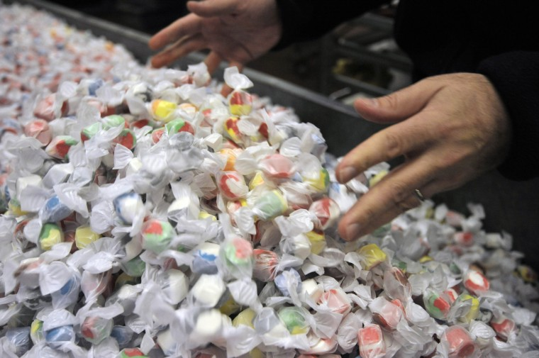 William Buppert, president of Mary Sue Candies, mixes up multi colored salt water taffy kisses. Production of the warm weather treat began on February 18 and Buppert says this is the beginning of summer vacation in the factory. (Kim Hairston/Baltimore Sun)
