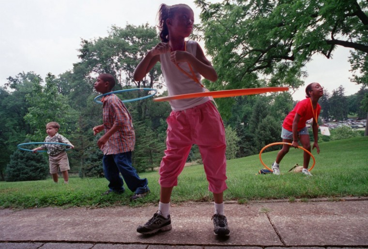 June 4, 2000: Grant-a-Wish/The Children's Promise Foundation host a picnic at the Baltimore Zoo....Makia Forrest (cq), 10, of Baltimore, leads others in hula hoops during the picnic. (Andre F. Chung/Baltimore Sun)