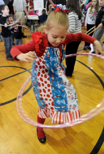 March 2, 2013: Dressed in her colorful Dr. Suess themed dress, Casidey Federowiczof Abingdon tries the hula hoop between sweet treats during Saturday's Chocolate Festival at the Bel Air Armory. (Matt Button/Aegis/Patuxent Publishing)