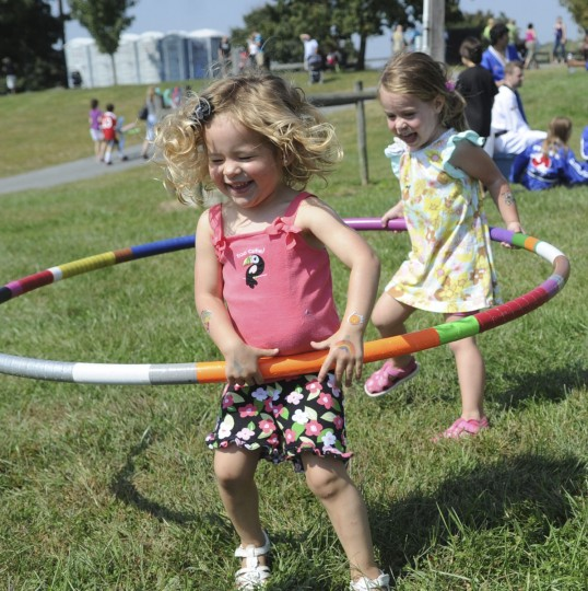 September 12, 2012: Madison Thomas of Forest Hill, center, and Reese Romano of Bel Air run around giggling while playing with a hula hoop at the 3rd Annual SARC Family Fun Day Saturday. (Nicole Munchel/Aegis/Patuxent Homestead)