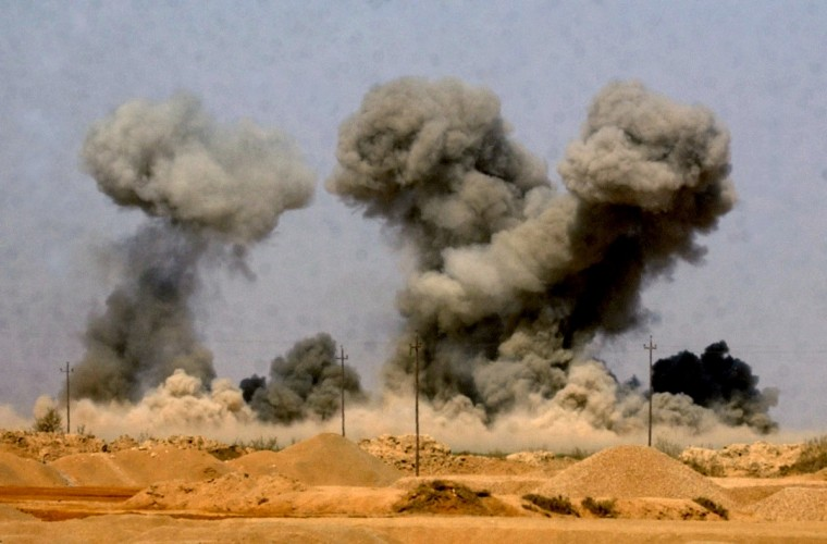 MARCH 27, 2003 -- Roughly 100 miles south of Baghdad, drops a bomb on an arms cache used by militia fighter. (John Makely/Baltimore Sun)