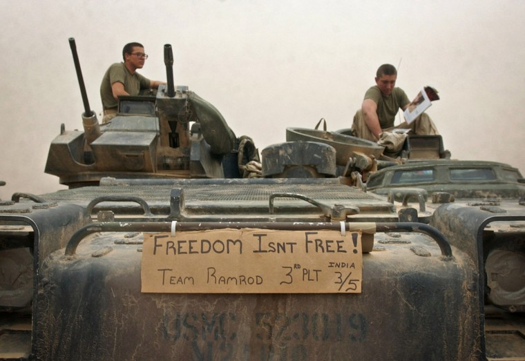 Baghdad, Iraq -- April 08, 2003 -- Although frowned upon by officers, India company Third Platoon posted a sign expressing their thoughts on the front of their AAV. (John Makely/Baltimore Sun