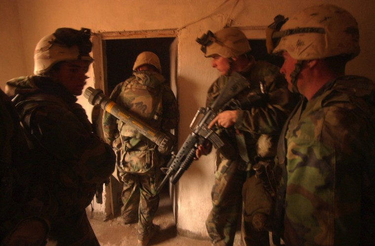 Iraq -- April 6, 2003 -- Less than fifteen miles southeast of Baghdad, U.S. Marines with India Company, 3rd Battalion, Fifth Regiment raid a regional Bath Party headquarters building during a patrol. (John Makely/Baltimore Sun)