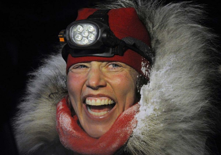 Aliy Zirkle finishes second in the Iditarod for the second consecutive year when her dog team crossed under the burled arch in Nome, Alaska on Tuesday evening, March 12, 2013. (Bill Roth/Anchorage Daily News/MCT)