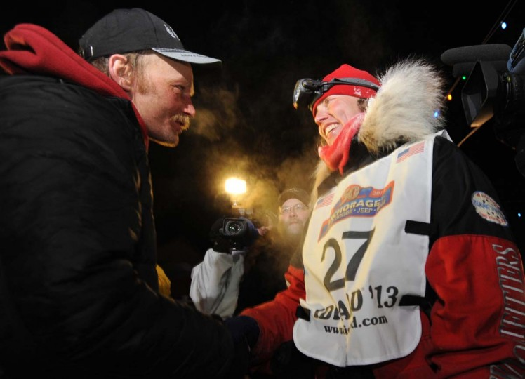 Mitch Seavey became a two-time Iditarod champion when he drove his dog team under the burled arch in Nome, Alaska on Tuesday evening, March 12, 2013. Seavey, 53, congratulates second place finisher Aliy Zirkle after she arrived in Nome. (Bill Roth/Anchorage Daily News/MCT)