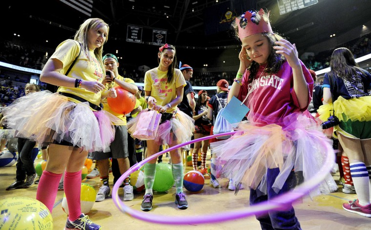 February 16, 2013: Alison Keim, 6, hula hoops as dancers from the kinesiology club, Kellie Hileman and Carli Menzel, cheer her on during the Penn State IFC/Panhellenic Dance Marathon at the Bryce Events Center in University Park, Pennsylvania. Dancers started the 46-hour fundraiser on Friday. The event, known as Thon, raises money to help families that are battling pediatric cancer. Last year's event raised $10 million. (Abby Drey/Centre Daily Times/MCT)