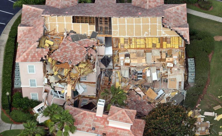 Buildings collapse into a sinkhole at the Summer Bay Resort on U.S. Highway 192 in Clermont, Florida, Monday, August 12, 2013. Guests had only 10 to 15 minutes to escape the collapsing buildings at the Summer Bay Resort on U.S. Highway 192 in the Four Corners area, located about 7 miles east of Walt Disney World resort, where a large sinkhole- about 60 feet in diameter and 15 feet deep- opened in the earth late Sunday. (Red Huber/Orlando Sentinel)