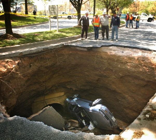 A car with two passengers fell into a sinkhole at Owings Mills mall on April 28, 2004. The two victims were flown to Shock Trauma. (Barbara Haddock Taylor/Baltimore Sun Photo)