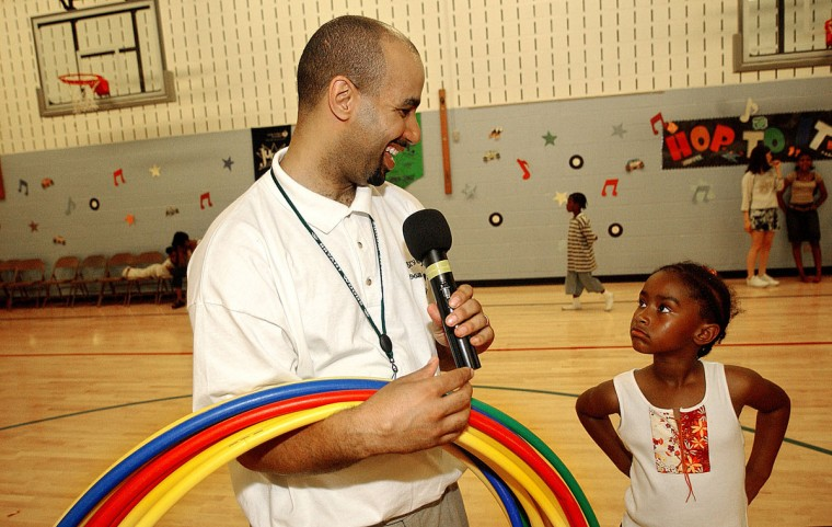 """May 14, 2004: Third grader Kelly Knight is the first in line to receive a Hula Hoop before the start of the third grade and under Hula Hoop competition during the Annual """"Sock Hop"""" event at Bryant Woods Elementary School. (Reid Silverman/Patuxent Publishing)"""