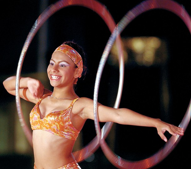 "June 7, 2002: Miss Karina Perez beams her way through a ""Hula Hoops Extraordinaire"" performance. (Sam Friedman/Patuxent Publishing)"
