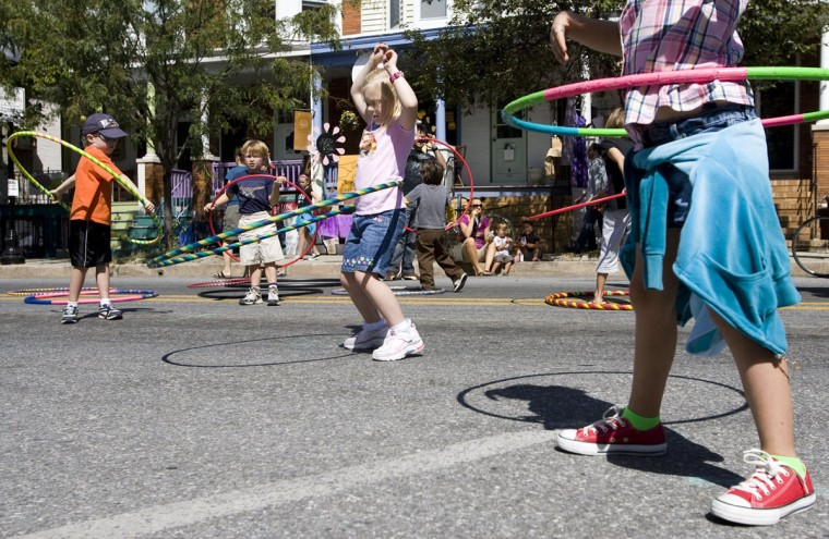 September 11, 2010: (L-R) Jack Long, 5, of Catonsville, Matthew Baker, 5, of Hampden, Julia Taylor, 6, of Ellicott City, and Lauren Taylor, 7, of Ellicott City play with hula hoops during Hampdenfest. (Sarah Pastrana/Patuxent Publishing)