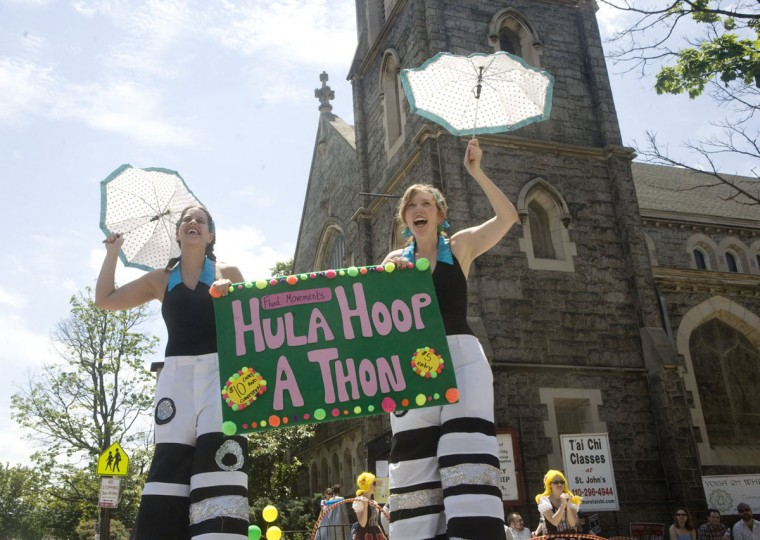 May 23, 2009: Stilters Kesling Kalb (left) of Hampden and Annie Howe of Hamilton welcome people to the fourth annual Hula Hoop-a-Thon in Charles Village. The four rounds of hula hooping competition included endurance, travelling, a challenge round and freestyle. The winner of the contest was crowned the 2009 Master of Hoops. (Sarah Nix/Patuxent Publishing)