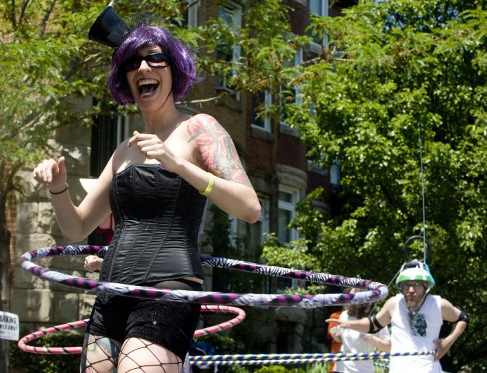 May 23, 2009: Kristine Bellinger (left) of Hampden and Andreas Spiliadis of Charles Village participate in Fluid Movement's fourth annual Hula Hoop-a-Thon in Charles Village. In the first round, competitors had to hula hoop for ten minutes without dropping their hoop. Spiliadis was eliminated in the first round, because his homemade large hoop was too unmanageable. Bellinger was eliminated in the second round, which required participants to race to the end of the block and back while hooping. (Sarah Nix/Patuxent Publishing)