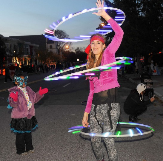 October 30, 2011: Dani Weissman, a serious hulu hooping hobbist, sports three neon lit hula hoops on Huntingdon Avenue in the Remington neighborhood that became Hauntingdon Avenue filled with spooky characters, games and music Sunday evening for locals to celebrate Halloween. (Karen Jackson/Patuxent Publishing)
