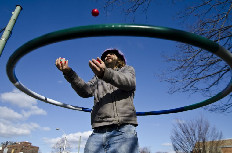 """February 25, 2012: Andreas """"Spilly"""" Spiliadis, a weekly fixture hoola-hooping at the 32nd Street Farmers Market, is getting a paid trip to Italy to try to set a Guiness world record in hula-hooping. Italian TV is paying his way. (Noah Scialom/Patuxent Publishing)"""
