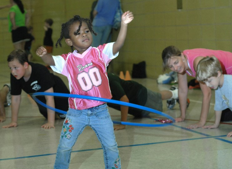 September 24, 2011: Naomi Mason, 3, hula hoops as Brick Bodies fitness instructors drill other students and their parents through push ups and a variety of fun exercises during Prettyboy Elementary school Family Fitness. The event, sponsored by the Parent/Teacher Association, was held to reinforce the lessons taught to students in physcial education classes on how to live a healthy lifestyle through exercise and proper nutrition. (Karen Jackson/Patuxent Publishing)
