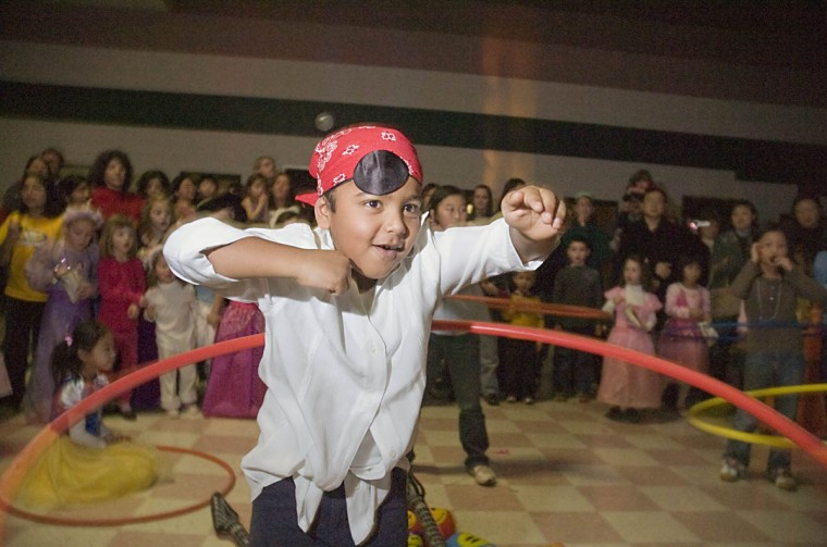 January 9, 2009: Kindergartener Sohan Gunawardane, 6, competes in the Hula Hoop contest during the Centennial Lane Elementary School Pirate & Princess Dance Party held at Burleigh Manor Middle School on Friday. Gunawardane won the kindergarten round of the contest. (Anthony Castellano/Patuxent Publishing)