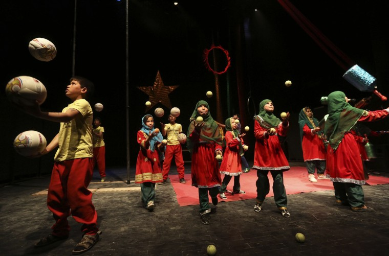 Afghan children from the Mobile Mini Circus Children (MMCC) perform during a show at the French Culture center in Kabu. (Omar Sobhani/Reuters)