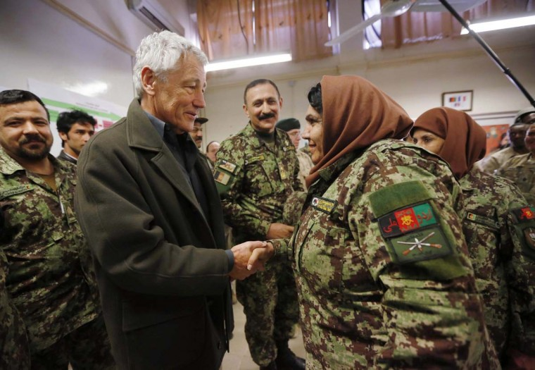 U.S. Secretary of Defense Chuck Hagel (L) shakes hands with a female Afghan non-commissioned officer under training, during his visit to the Kabul Military Training Center in Kabul March 10, 2013. It is Hagel's first official trip since being sworn-in as Obama's Defense Secretary. (Jason Reed/Reuters)