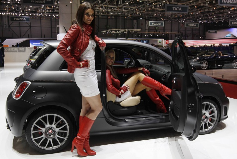 Models present the Abarth 695 Black Diamond on the company's booth during the first media day of the Geneva Auto Show at the Palexpo in Geneva. (Denis Balibouse/Reuters photo)