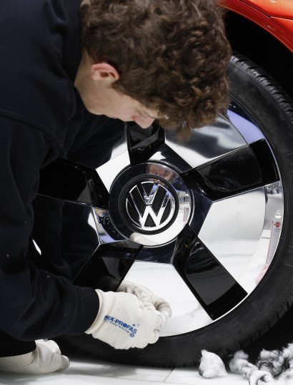 A staff cleans the rim of a Volkswagen concept car during the second media day of the 83rd Geneva Car Show at the Palexpo Arena in Geneva. (Denis Balibouse/Reuters photo)