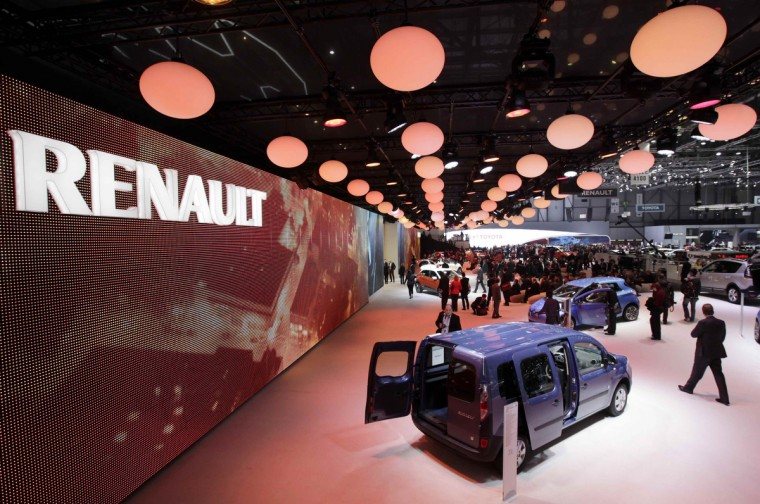 Visitors walk around the exhibition stand of Renault during the first media day of the Geneva Auto Show at the Palexpo in Geneva. (Denis Balibouse/Reuters photo)