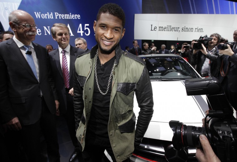 Recording artist Usher (C) poses after the presentation of the new A 45 AMG model car during the first media day of the 83rd Geneva Car Show at the Palexpo Arena in Geneva. (Denis Balibouse/Reuters photo)